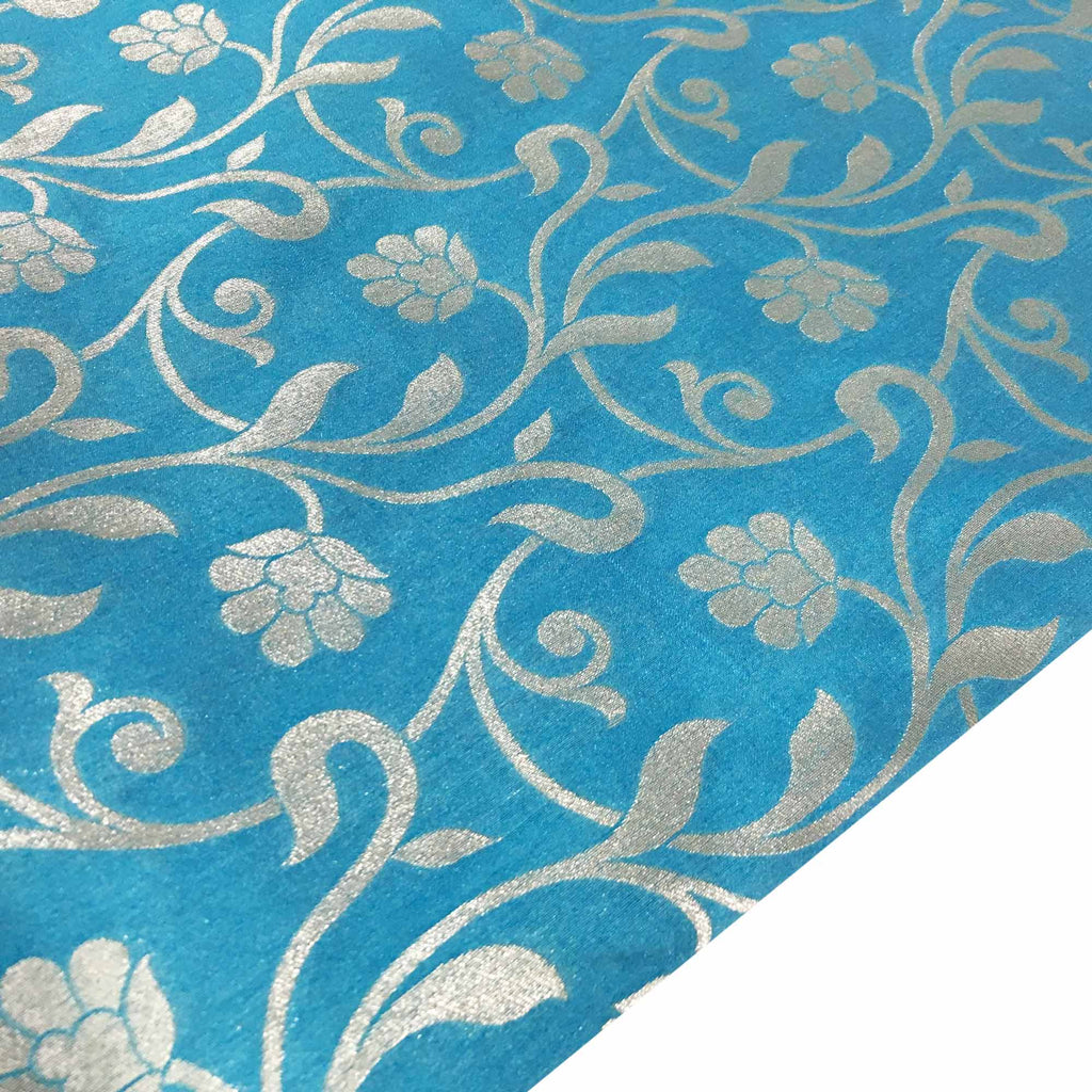 Teal and silver polyester jacquard fabric