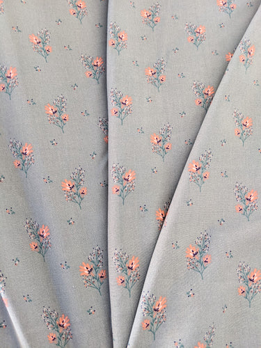 Gorgeous floral viscose fabric. Pastel mint/blue/green background with a cute peach flower print all over. Perfect for dressmaking