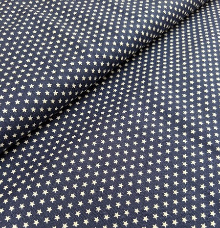 Navy cotton fabric with tiny white star print.