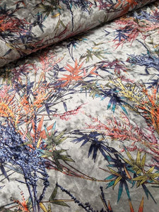 Super soft velvet colourful leaf print fabric with a stretch.