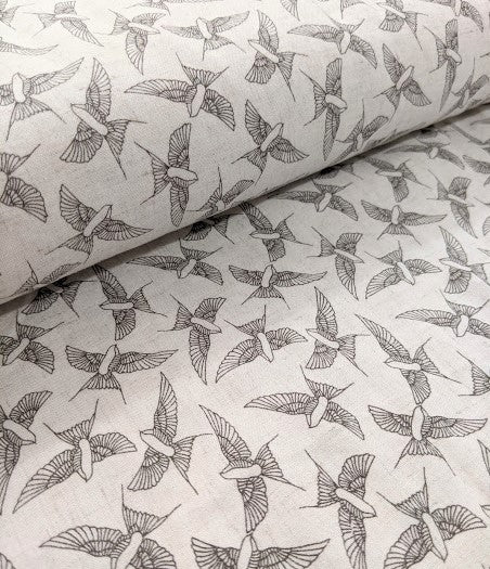 Gorgeous linen look swallow print viscose fabric. 140cm wide.