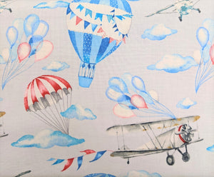 Gorgeous cotton fabric with a hot air balloon and planes print