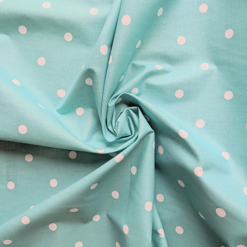 Light turquoise spot cotton fabric.