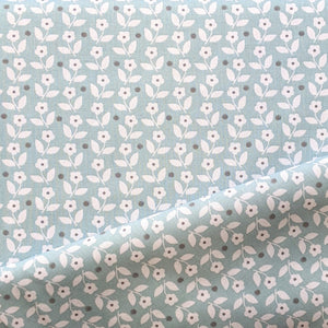 Mint green/blue background with white ditsy floral and dot cotton fabric