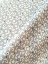 Load image into Gallery viewer, Mint green/blue background with white ditsy floral and dot cotton fabric