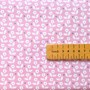 Pretty pink background with white ditsy floral and dot cotton fabric