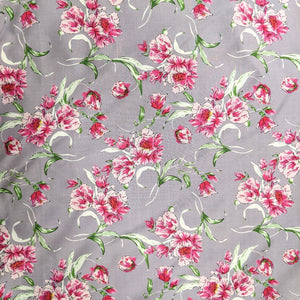Pretty pink floral viscose on a mauve background