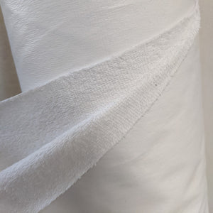 white plastic backed cotton towelling
