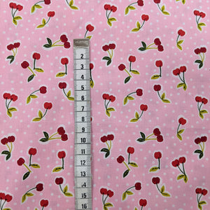 Cherries on pink cotton fabric (wide) - 1/2 mtr