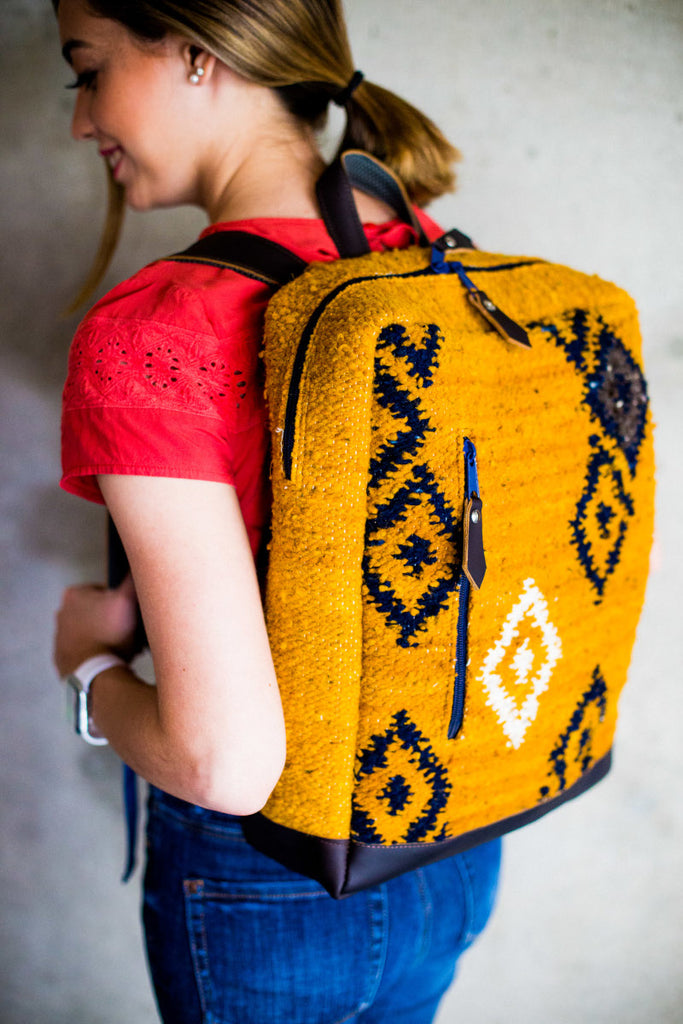 Handmade-backpack-fuego-yellow-model-wearing
