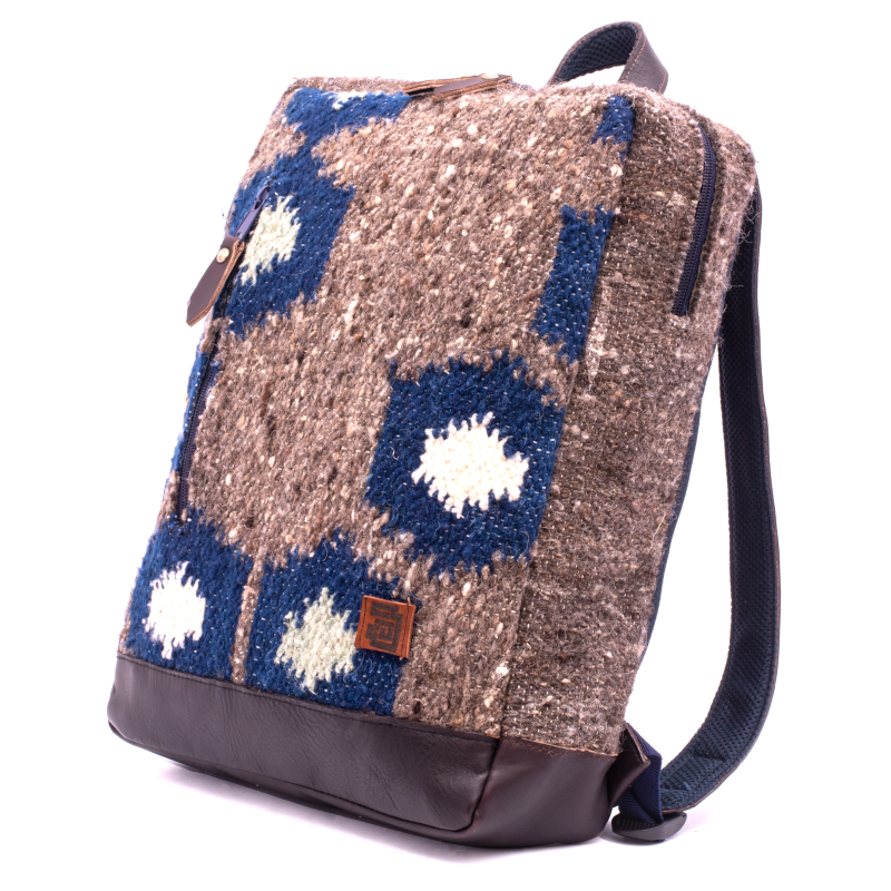 Handmade wool and leather Achiote Tierra backpack lay