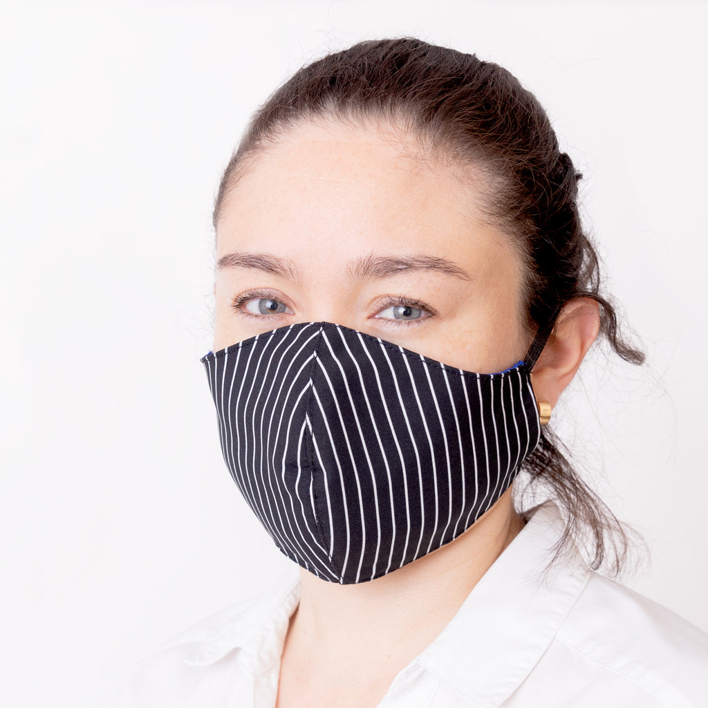 Achiote face mask antifluid antimicrobial black white lines wearing front