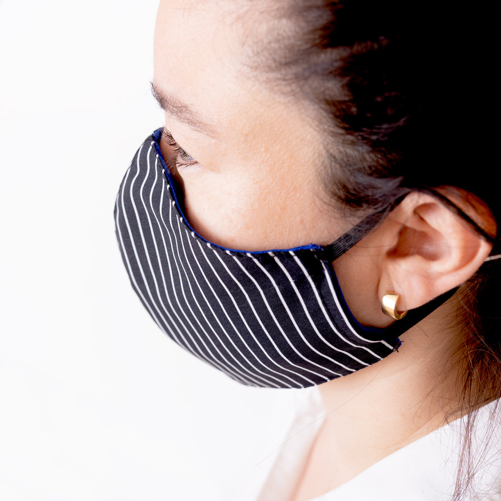 Achiote face mask antifluid antimicrobial black white lines wearing side angle
