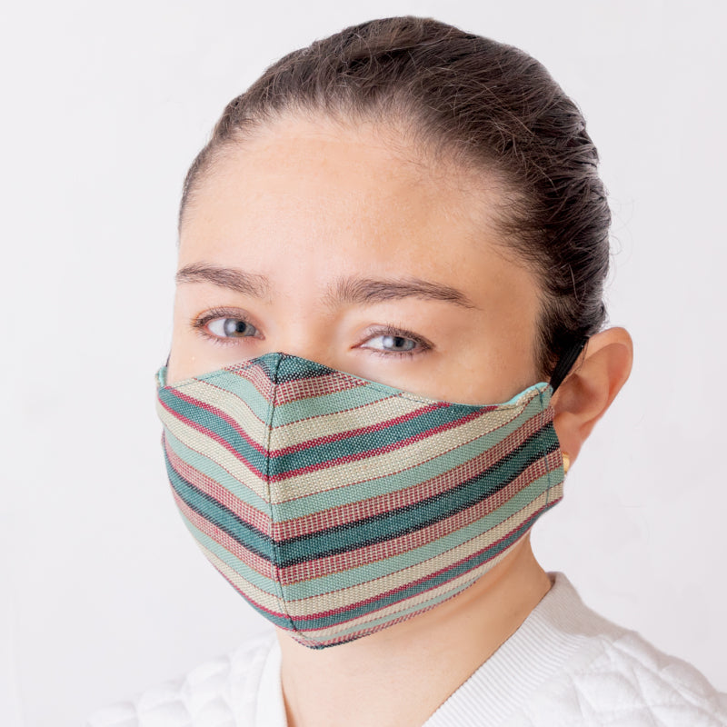 Achiote cotton handmade facemask jade wearing front face