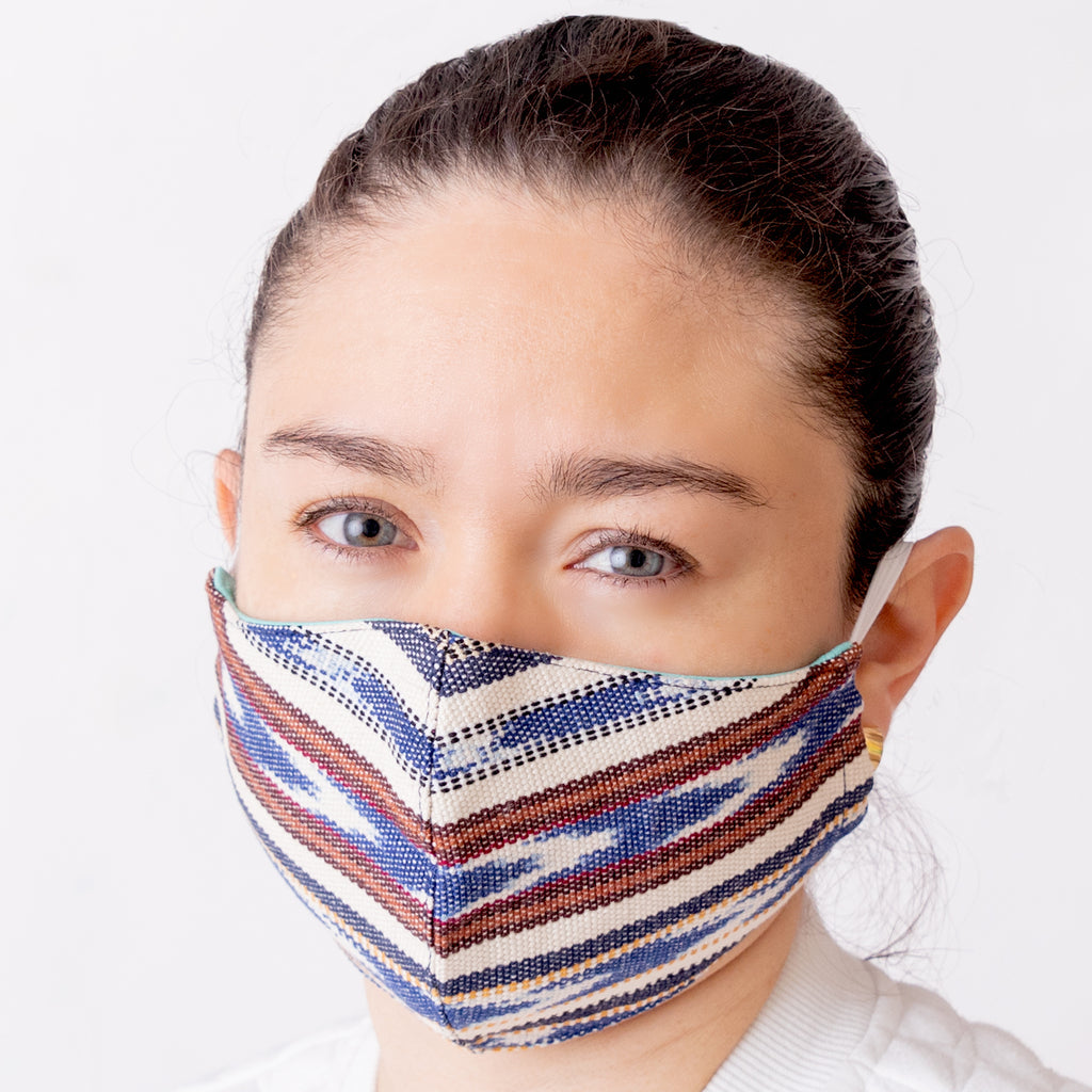 Achiote cotton handmade facemask Indigo wearing front face