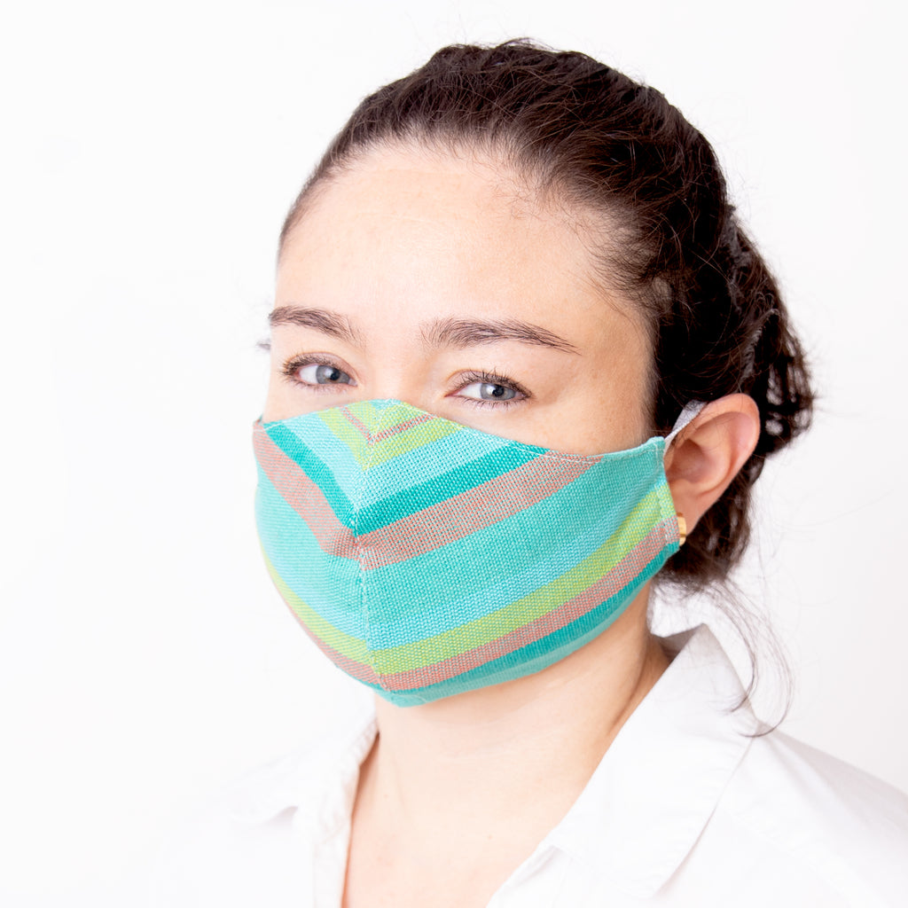 Achiote cotton handmade facemask mint wearing front face
