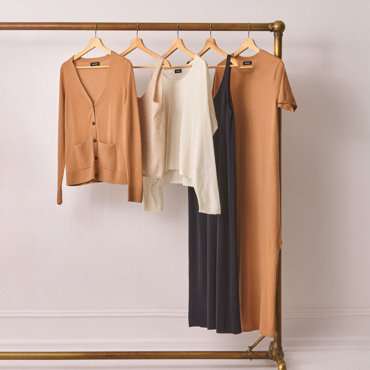 Ultra Fine Cashmere products hanging on a rack