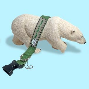 Polar Bear Protector green hemp collar draped over back of tabletop polar bear