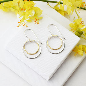 gold and silver double circle earrings