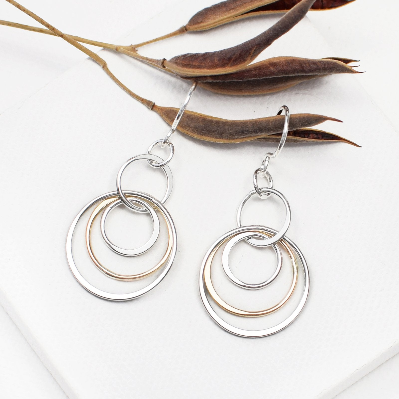 two tone circle dangle earrings
