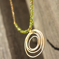 Tequila Sunrise Necklace - 18k Gold Swirl Charm, Green Peridot & 18k Gold Nuggets Necklace.