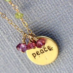 Peace Stamp Necklace - 18k Gold Charm, Pink Topaz & Peridot Necklace.