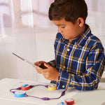 Kids learning working of science circuit conductor kit