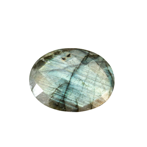 A Labradorite semi-precious gemstone. It has a dark grey colour, with a shiny white and blue light, and blue stripes running through it.