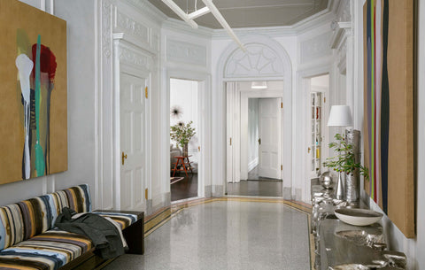 Dramatic foyer with high ceilings, art on the walls