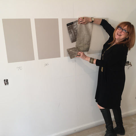 Robin Baron matches a fabric swatch to a wall paint color sample