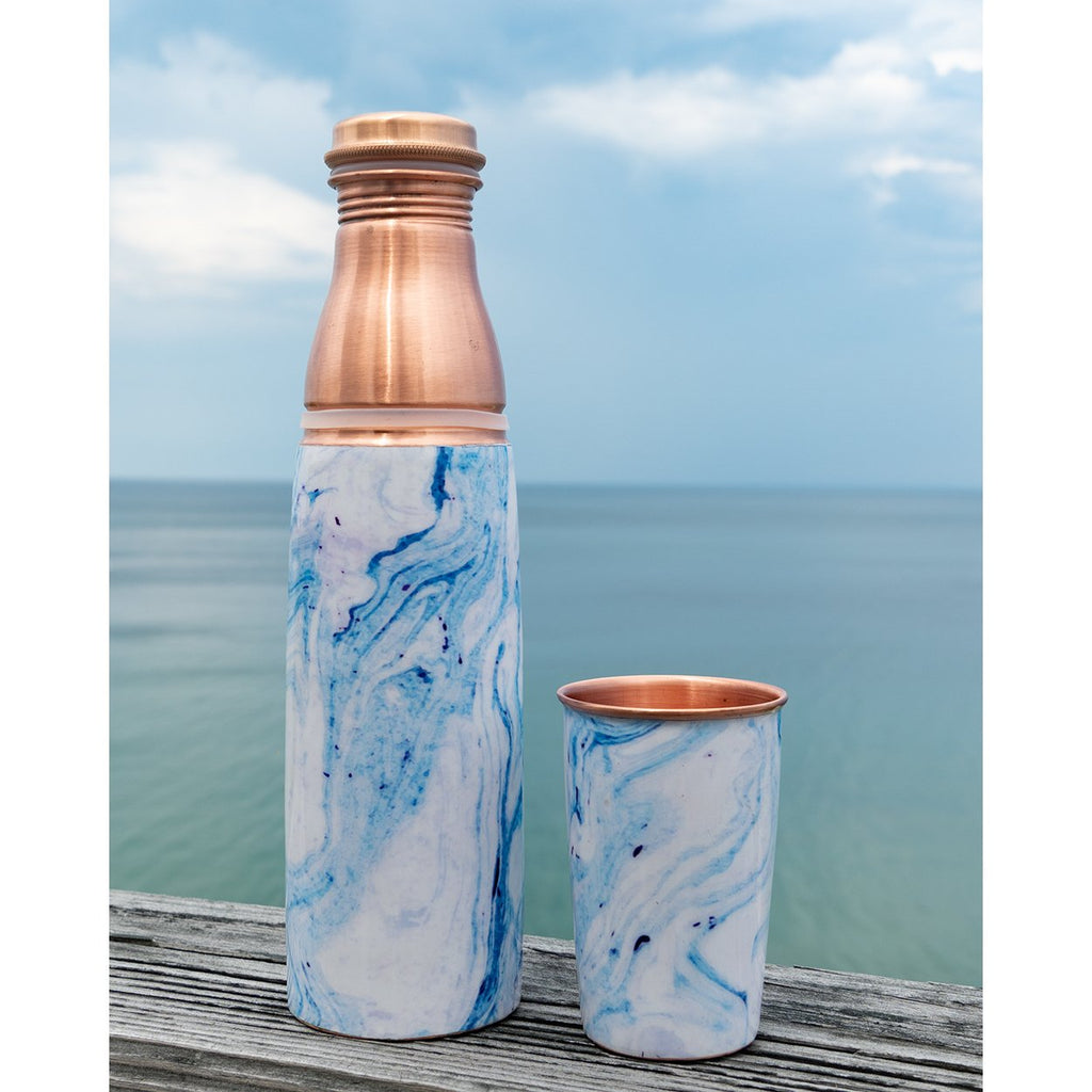 Somme Blue Marbled Copper Water Bottle with Cup, lifestyle view with cup on