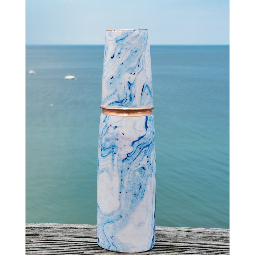 Somme Blue Marbled Copper Water Bottle with Cup, lifestyle view with cup off