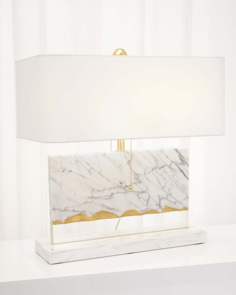 Flotteur Table Lamp, lights-on angled view