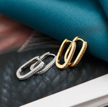 Load image into Gallery viewer, Oval Huggie Hoops with Clear Stones, Gold