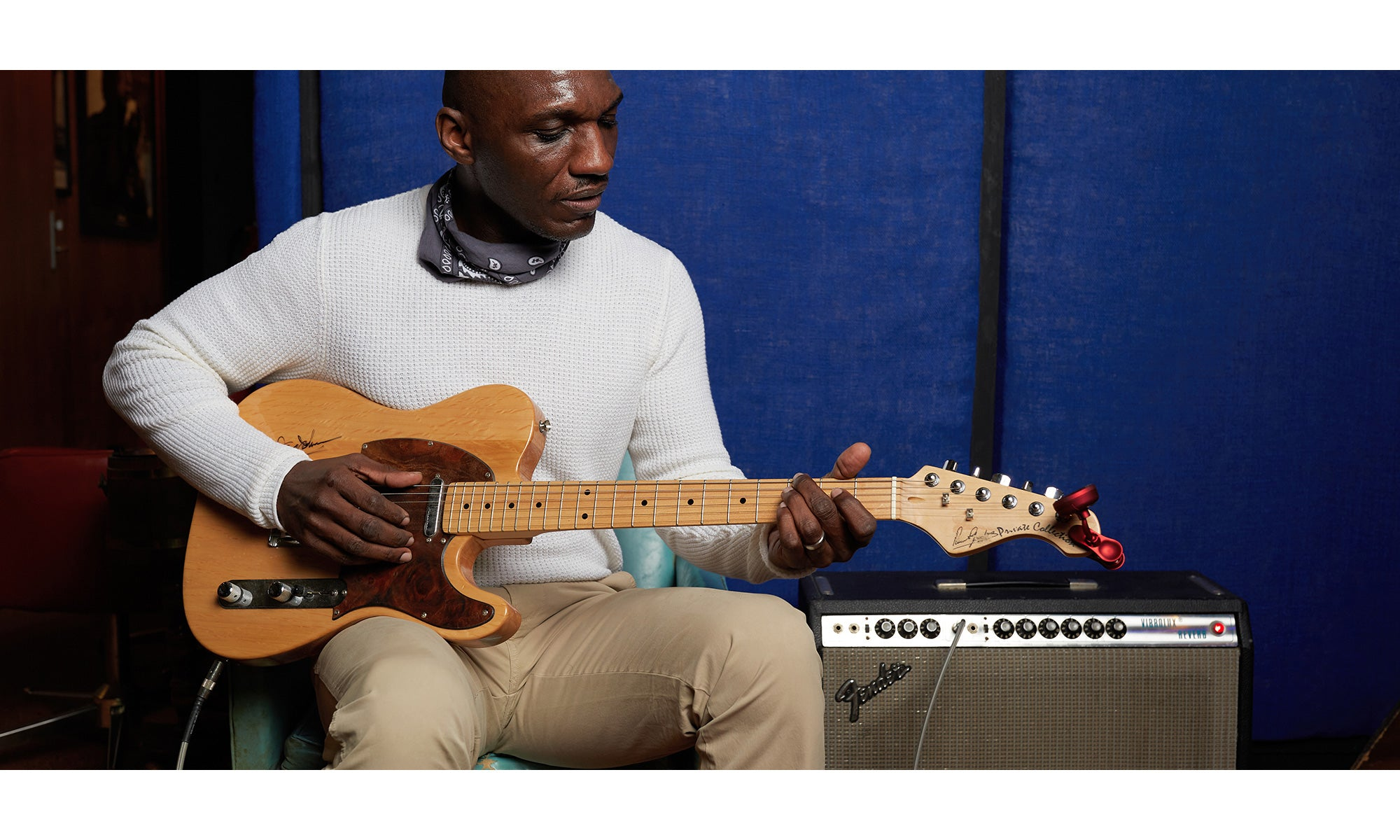 Photo of Grammy-nominated singer/songwriter Cedric Burnside playing electric guitar at the famous Shoals Theatre in Muscle Shoals, AL. He is wearing the Mini Waffle Knit Crew paired with the Pima Cotton Chino Pants.