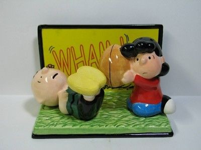Charlie Brown and Lucy Play Football Salt and Pepper Shakers