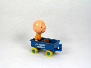 Charlie Brown in metal wagon