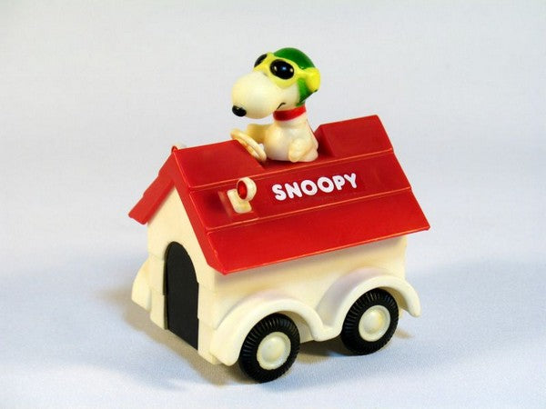 Snoopy rides on doghouse