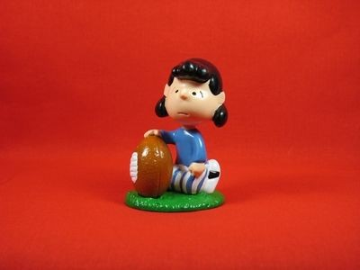 LUCY HOLDS FOOTBALL PVC