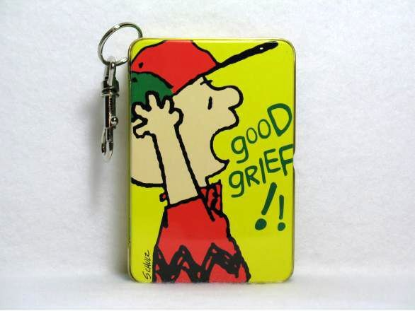 Charlie Brown key chain tin
