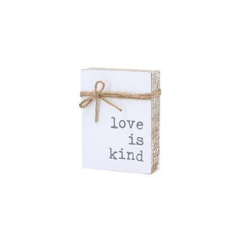 Collins Painting & Design, LLC Love Is Kind Wood Sign available at The Good Life Boutique