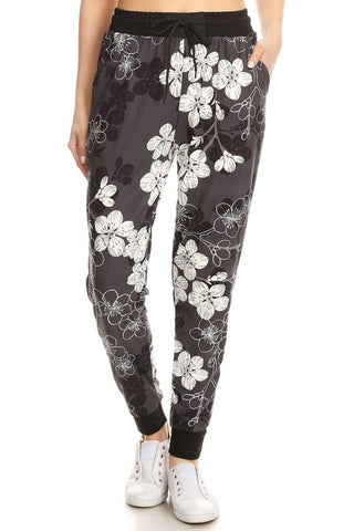 Love It Floral printed Sweatpants/Joggers with solid trim side detail available at The Good Life Boutique