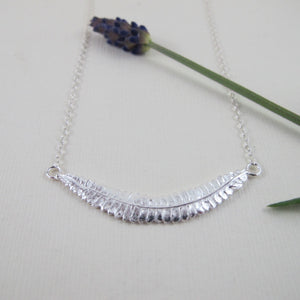 Young fern imprinted bar necklace from Sandcut Beach on Vancouver Island, BC