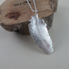Load image into Gallery viewer, Stellar's Jay feather imprinted necklace from Victoria, BC by Swallow Jewellery
