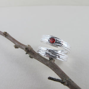 Arbutus tree bark imprinted wrap ring with orange Sapphire from Galiano Island - Swallow Jewellery