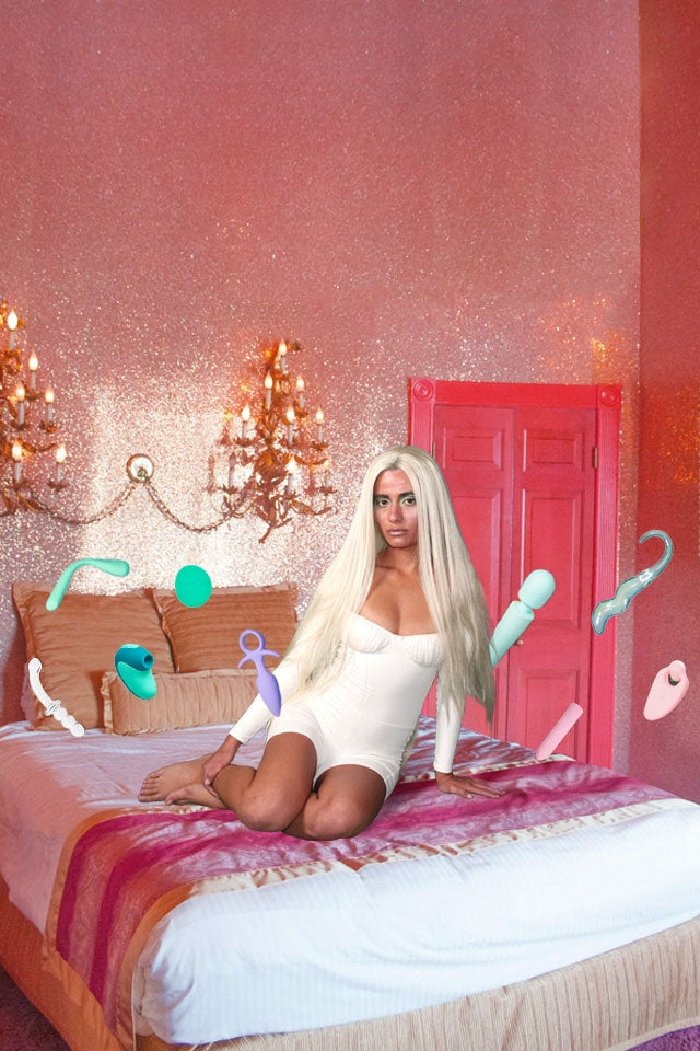 Women in white dress on bed with Unbound vibrators floating in a circle around her