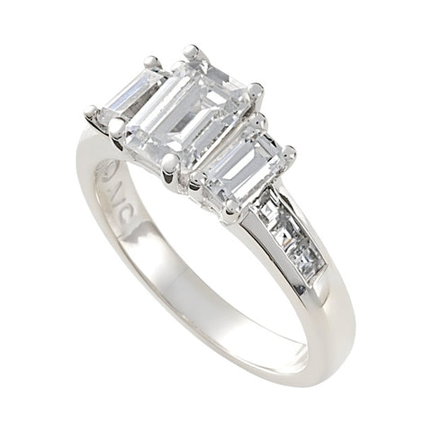 Three Stone Emerald Cut Diamond Ring With Channel Set Diamonds On The Side