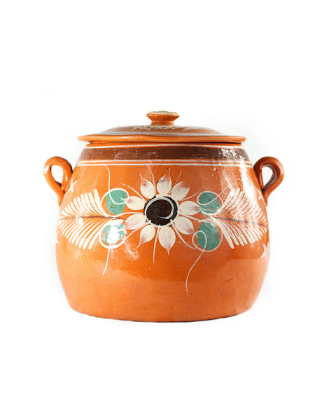 Terracota pot with lid.