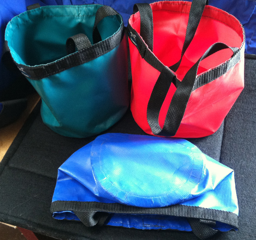 Blue, green, and red foldable vinyl water buckets.