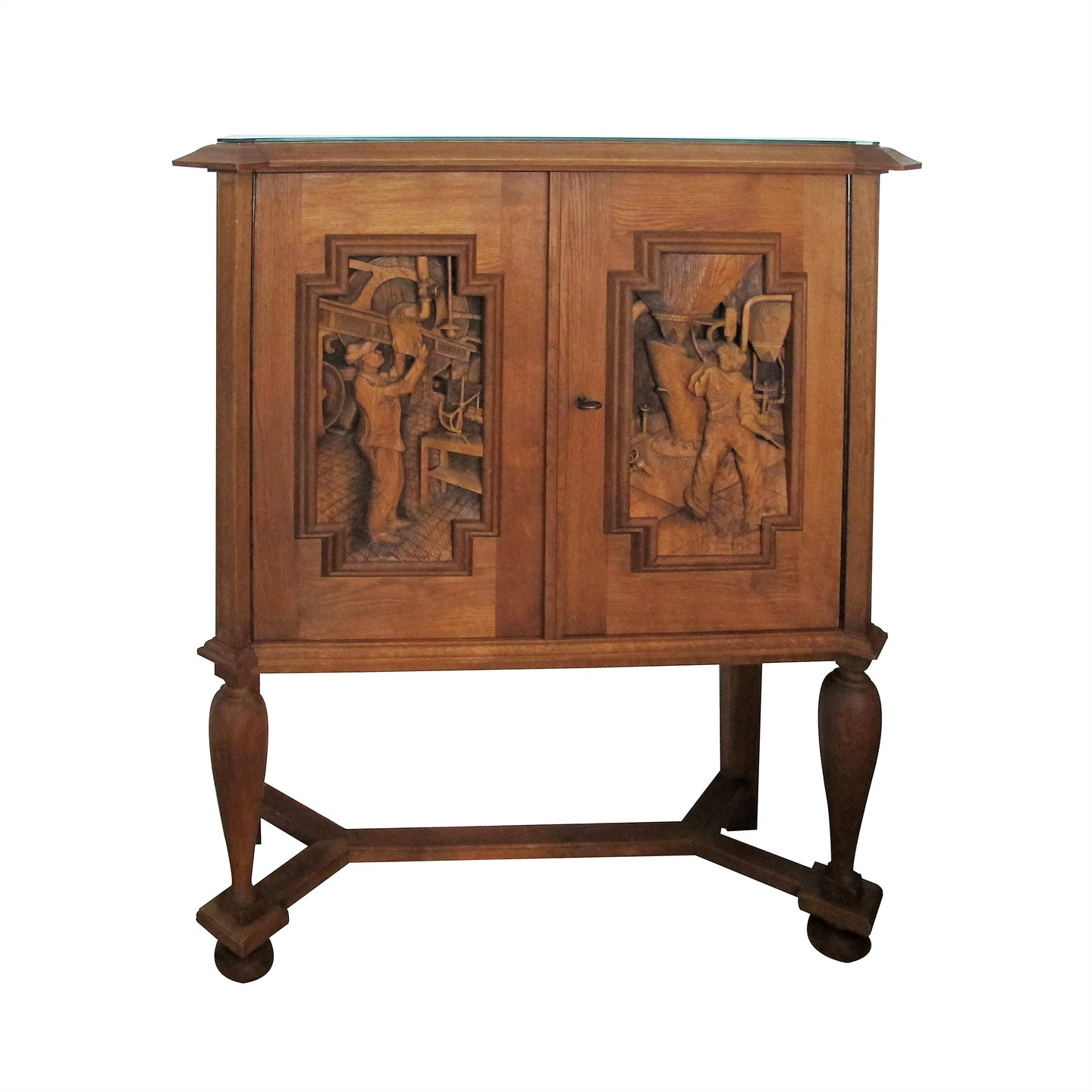 A 1940's oak cabinet with carvings by E. Hallanvaara, Finnish